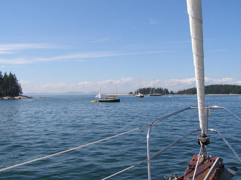 AUKLET anchored in the White Islands, as seen from the bow of KESTREL.  August, 2012.  Photo: Patsy Munger