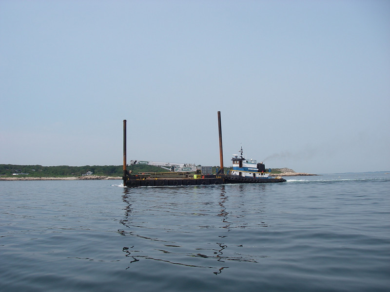 Leaving Rockport first thing in the morning, with this interesting dredging barge going by.  July, 2012.