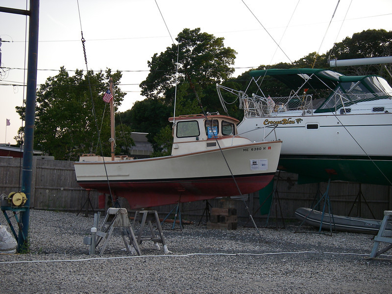 A sweet little boat, tucked in with all the big ones.