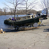 Theo and Shemaya and the boat, off the water.  November 17, 2012, Deep River, Connecticut.  Photo: Suzanne Jean