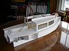 the model has a stand, and the keel and rudder are not built into the model.  The rudder stock, however, is drawn onto the side of the stand.