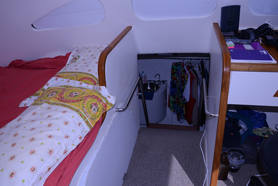 Looking down into starboard hull and my cabin; note pressed Hawaiian shirts.