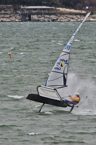 The windward wing hits a wave and John is rewarded with a  spray of 50 degree water to the face.  Brrr.