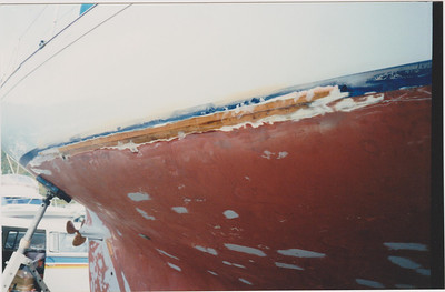 Back to bare timber, waterline starboard side.