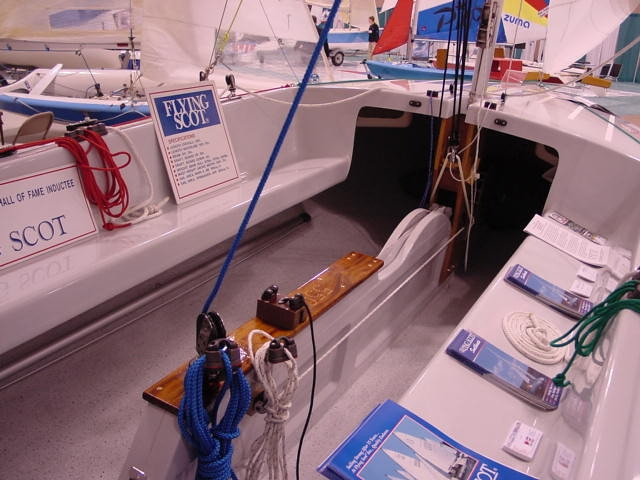 Forward View of the Flying Scot Cockpit at the Boat Show.  The Flying Scot cockpit is roomy enough for up to 6 adults with ample storage under the seats and forward deck for large lunch cooler and supplies.