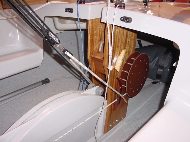 """The Flying Scot centerboard is controlled with the a line the wraps up on the 8"""" drum located on the starboard side of the stanchion. Two rollers attached to the centerboard roll along the trunk as the centerboard is raised and lowered.  The rollers reduce friction making  the centerboard easy to adjust.  The boom vang is attached to the base of the stanchion via a bridle system.  Jam cleats come standard on the port and starboard sides of the stanchion."""