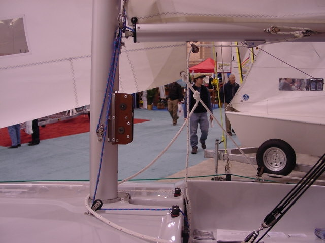 The Flying Scot is equipped with a set of small winches for rising the main and jib halyard.  The winch assembly is attached to the mast just below the boom.
