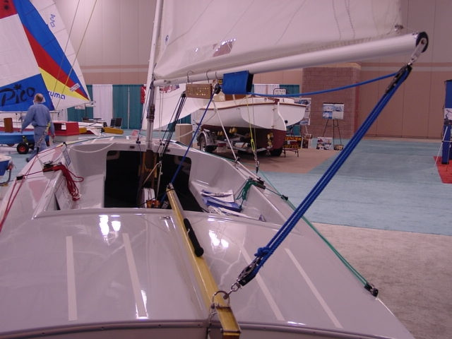 The aft deck of the Flying Scot provides additional storage and protection for item like a cooler, life jackets, and/or an outboard motor.  The boom has been placed at a height that allows for plenty of head room while tacking.  Non-skid strips are added to both the forward deck and aft deck for added safety.
