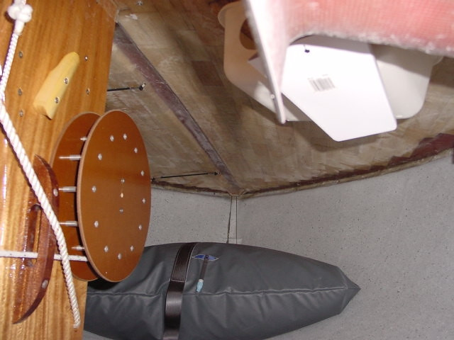 The bow of the Flying Scot offers additional space for storage of sailing gear.  For additional buoyancy, each Flying Scot is equipped with a  flotation bag strapped into the forward area of the bow.  The drum to the left provided the 16:1 mechanical advantage for rising and lowering the ballasted center board.
