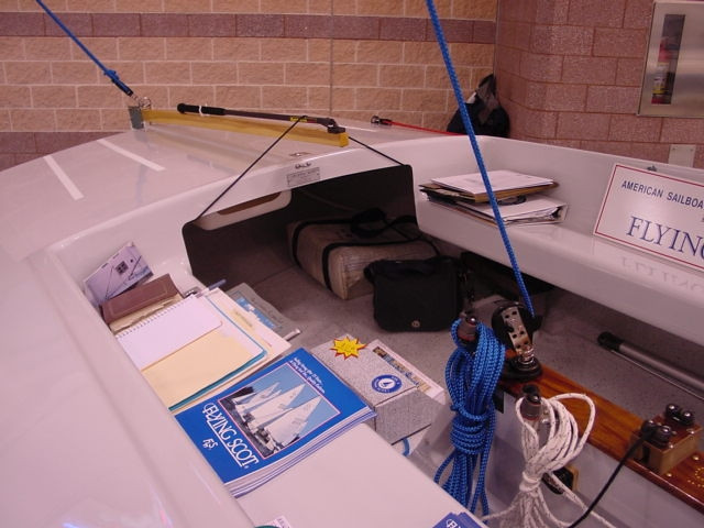 Aft View of the Flying Scot Cockpit at the Boat Show.  The Flying Scot cockpit is located forward of the tiller so everyone is comfortable including the skipper.  The area under the aft deck adds more storage for supplies and is a great location to store the outboard motor when not in use.