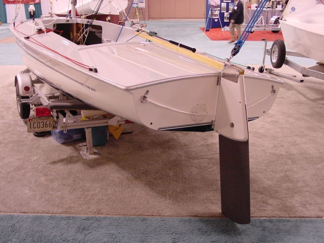 "The Flying Scot Rudder draws 18"" when it is full down.  A safety line attaches between the two rings attached to the transom provides something to hold onto while swimming on a hot summer day, or serves as a place to hold onto if someone fall overboard unexpectedly."