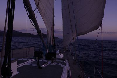 Light winds, and eased sheet sail to our anchorage, around next headland. Note tidy and organized deck.