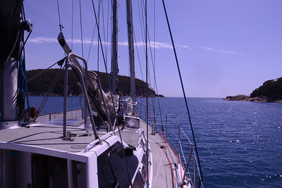 Entrance to Refuge Cove, seen from anchorage.  In the new design I would try and position main mast forward of the deck house so the boom and mainsail are more accessible.