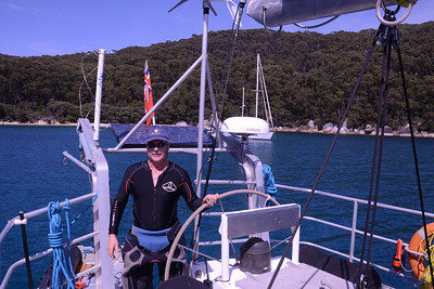 Back on board, warming up after a dive.  Water temp 61 degrees C; it was cold,even with two wetsuits on.
