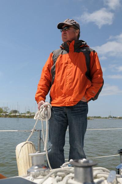 Tom Gehringer stands prepared for Rock Hall docking maneuvers.