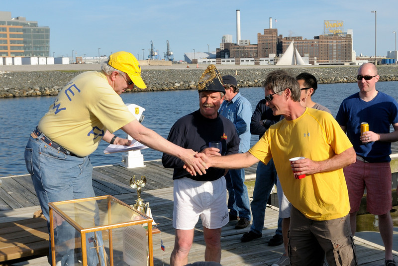 "Randy Beitler of ""Legacy"" receives a congratulatory handshake for a successful man-overboard rescue. Someone give him a roll of Lifesavers."