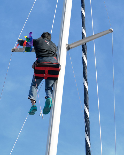 "Removing (or are they attaching?) the Gay Pride flag on ""Wind Dancer."" Give it to ""Gay Force!"""