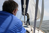 "Adjusting the main halyard on ""Gay Force"""