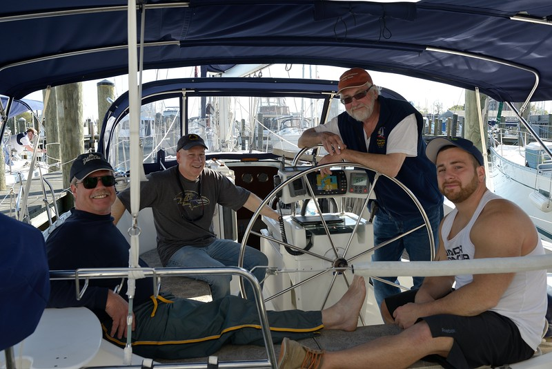 Commodore Ondra and Chaplin Rudy Hilt with Crew