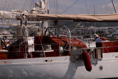 "Traditional yacht, ""Amilia"", a Milne design,  at adjacent marina with brilliant varnish work over red-stained teak."