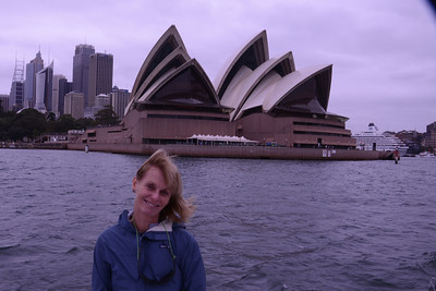 Our guest, with Opera House, and cruise ship at Circular Quay.