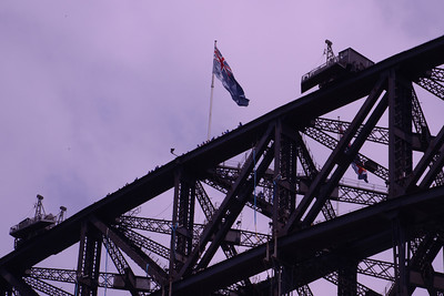 Australian flag flying atop Sydney Harbour Bridge.