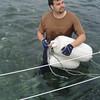 Crew member Dan rigging some fenders for the underside so the boat will rest easier on the rocks.