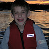 Brandon at Sunset...yeah, he's pretty unhappy on the boat!!