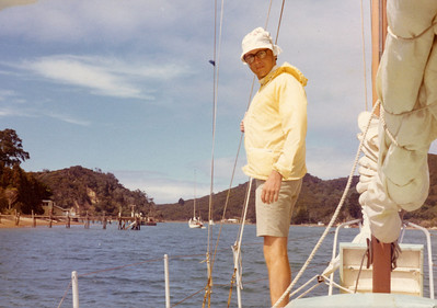 In Bon Accord Harbour, Kawau Island, aboard the little sloop, and well covered up for sun protection.