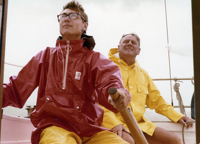 Dad and I, sailing in heavy rain, Kiwi style. Barefeet.