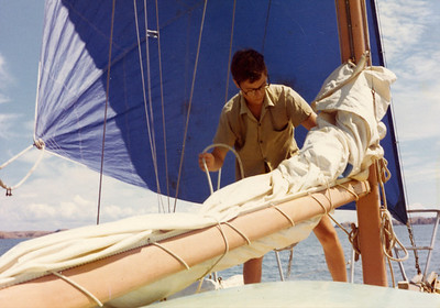 For'd hand tending to mainsail, inner Hauraki Gulf. In those days forw'd hands were skinny as they were not fed very much!