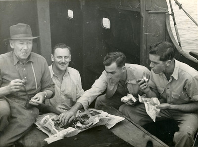 """This photo is in the realm of the unknowns, is it the """"Waipru"""", but Dad does look older.  A timber vessel with deck house. I had a communication from a reader who believes that the chap on the left is her Dad,  Jack """"Hutch"""" Hutchinon, who was Dad's mate in the War."""