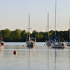 Sailboats resting peacefully at anchor on a clear nice sunset