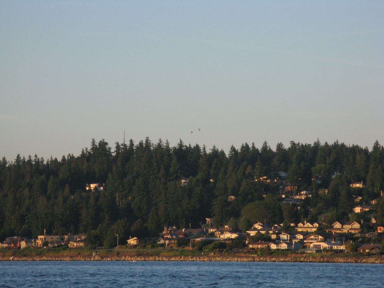 The two faint dots above the horizon in the middle of the picture are hot air balloons.  They depart from Snohomish, Washington, which is about 20 miles from Edmonds.