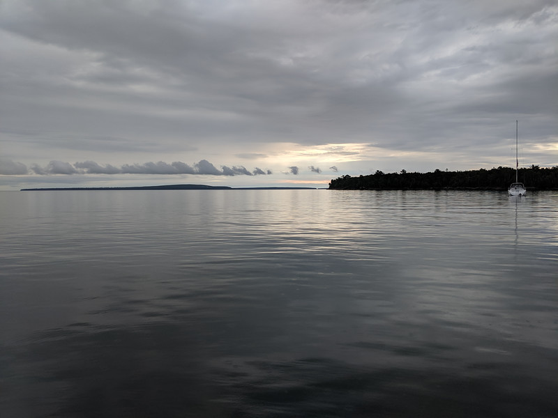 The next morning the  lake was glassy. The closer land on the right is York, the island we anchored by. In the distance is Bear Island. 90 degrees to the left of this view is open the Lake, so we were fully exposed to the north the night before.