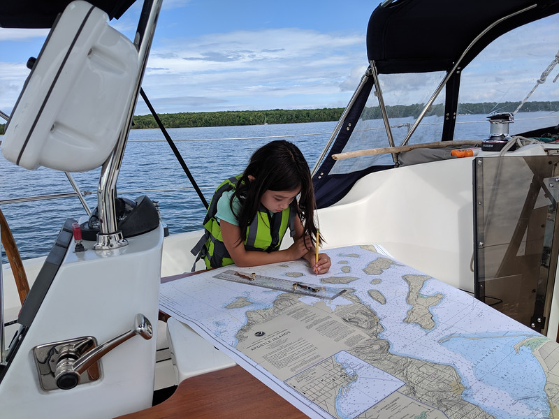 Maddie helped me take a fix by sighting 3 landmarks and plotting the intersection of their bearings on the map. Just a fun exercise since we had the GPS.
