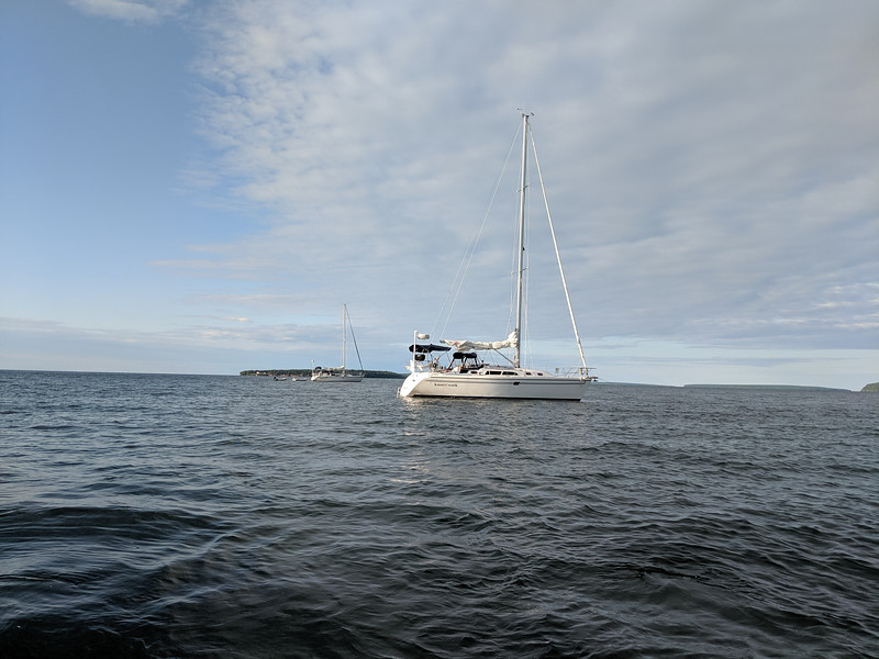 We anchored in Raspberry bay and rowed ashore in the dinghy to explore the beach.