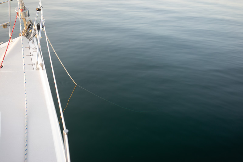 Anchor rope disappearing into the depths.