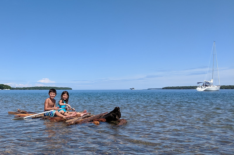 The kids made a raft out of driftwood and paddled it up and down the shore.