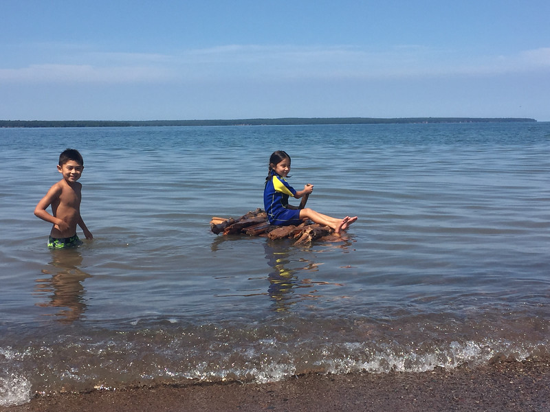 The kids made a raft out of driftwood and paddled it around!