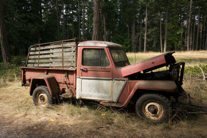 Old truck, no engine, near the schoolhouse