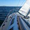 Crossing the Strait, reefed, small jib, lots of heel