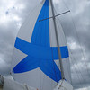 Spinnaker flying against dark clouds