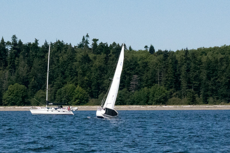I'd never seen an inflatable dinghy carried this way on a sailboat.  Seems to work unless you heel too much.