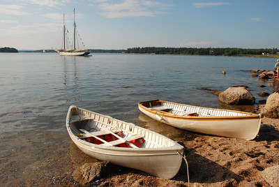Boats on the beach w Schooner in background