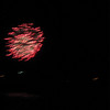 Fireworks over Hampton Beach, rippling as the camera moves with the boat.<br /> [photo by Sandy Ward]