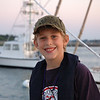 Brandon fishing at sunset in Scituate