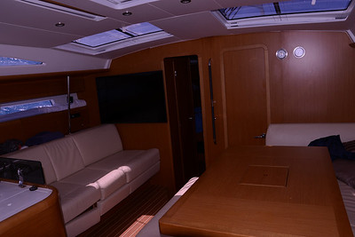 Comfortable main cabin.  Storage under seats on port and starboard sides of the main cabin.  Well lite.