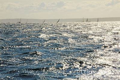 Sailing fleet wide view on breezy afternoon.