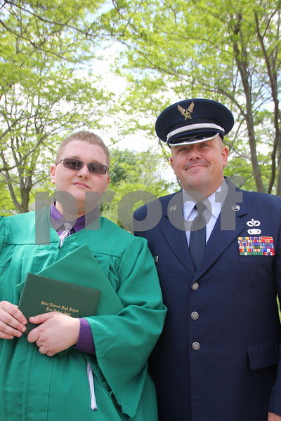 Taking time out for a picture after the graduation  for Saint Edmonds is (left to right): Colter Scholtens and Eric Reese